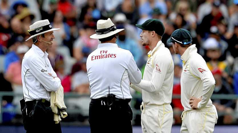 Cameron Bancroft and Steven Smith are quizzed by the umpires on day three of the third Test against South Africa, in Cape Town on March 24.  Picture: Ashley Vlotman/Getty Images