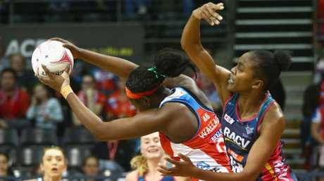 Sam Wallace of the Swifts and Kadie-Ann Dehaney do battle in the goal circle. Picture: AAP