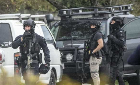SERT officers are seen at the scene of a police operation at Alexandra Heads.