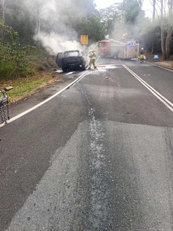 Kelly Hourigan and her young family were driving along Sunrise Road, Doonan yesterday. Their BMW 4x4 was towing a horse float when the car began to fill with smoke and catch fire.