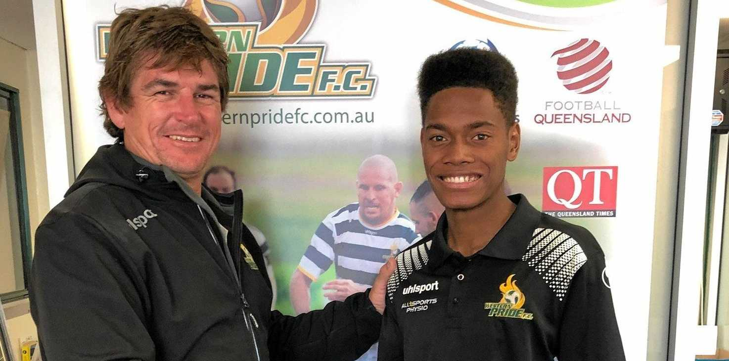 ONGOING DEVELOPMENT: Western Pride general manager Pat Boyle congratulates Dan Hall on recently being recruited by the Central Coast Mariners.
