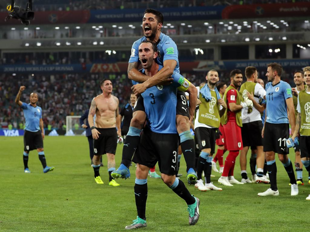 Luis Suarez of Uruguay and Diego Godin of Uruguay celebrate at full time. Picture: Getty Images