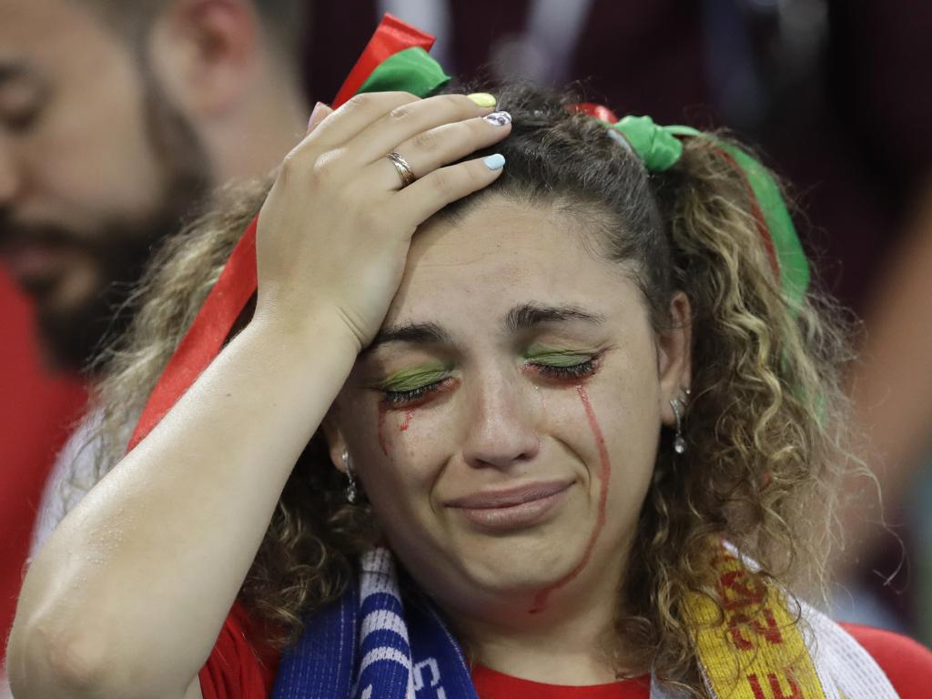 A Portugal fan cries after the round of 16 match between Uruguay and Portugal at the 2018 soccer World Cup. Picture: AP Photo