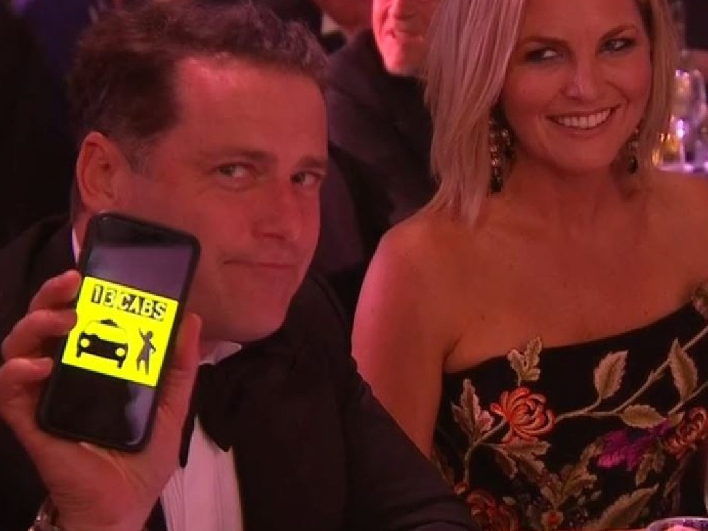 Karl Stefanovic, Lisa Wilkinson and Georgie Gardener react during Dave Hughes' opening Logies speech Picture: Channel 9