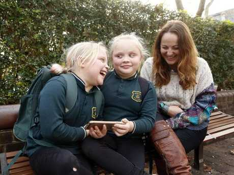 Nyree Monaghan won't her twins Milla and Neeah, 9, spend money on apps. Picture: David Swift