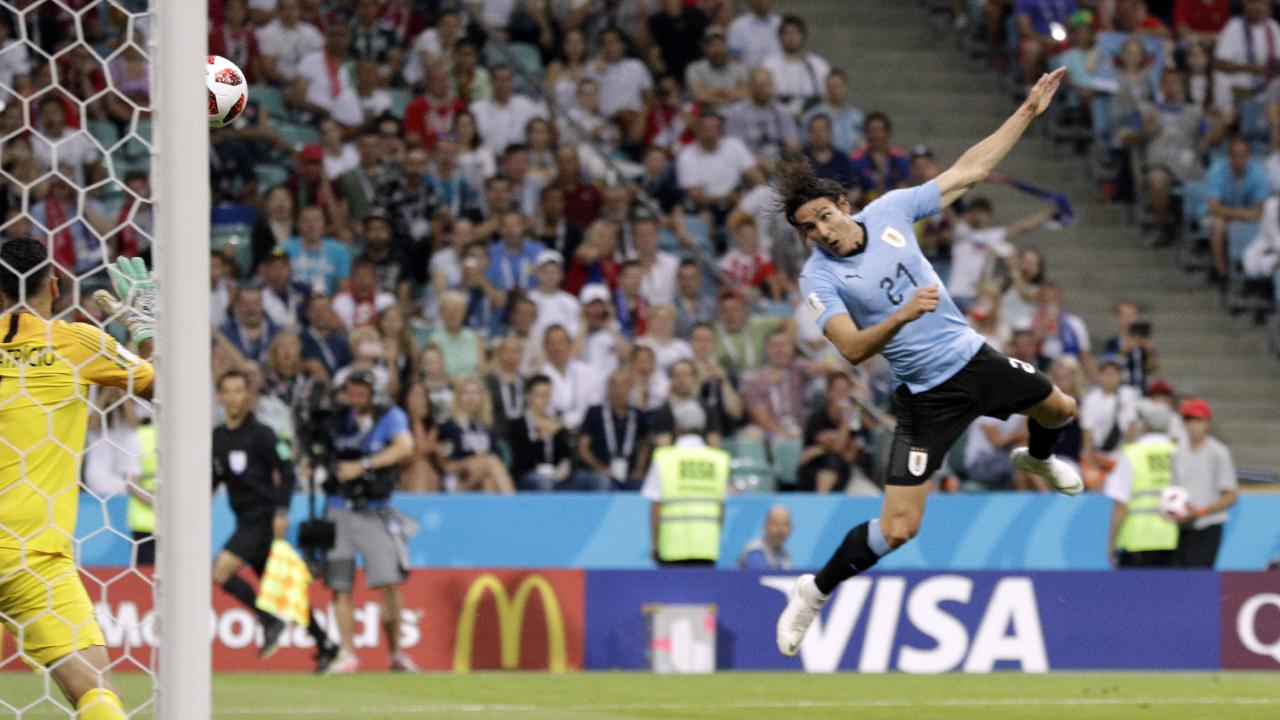 Uruguay's Edinson Cavani scores his side's opening goal. Picture: AP Photo
