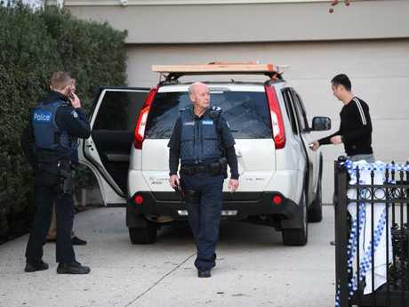 Police outside the home. Picture: Lawrence Pinder