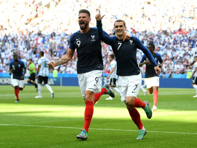 Antoine Griezmann celebrates with teammate Olivier Giroud after scoring his team's first goal. Pic: Getty