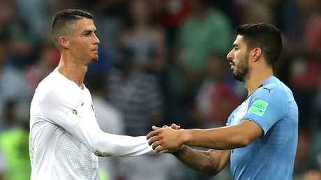 Cristiano Ronaldo and Luis Suarez shake hands after Uruguay's win over Portugal in their round-of-16 clash at the World Cup. Picture: Francois Nel/Getty