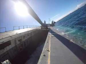 Ex-HMAS Tobruk descends below the surface