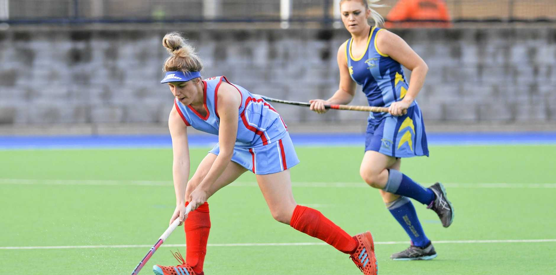 Swifts' goalscorer Macey Reilly finds room to run in Saturday's A-Grade match against Hancock Brothers at the Ipswich Hockey Complex.