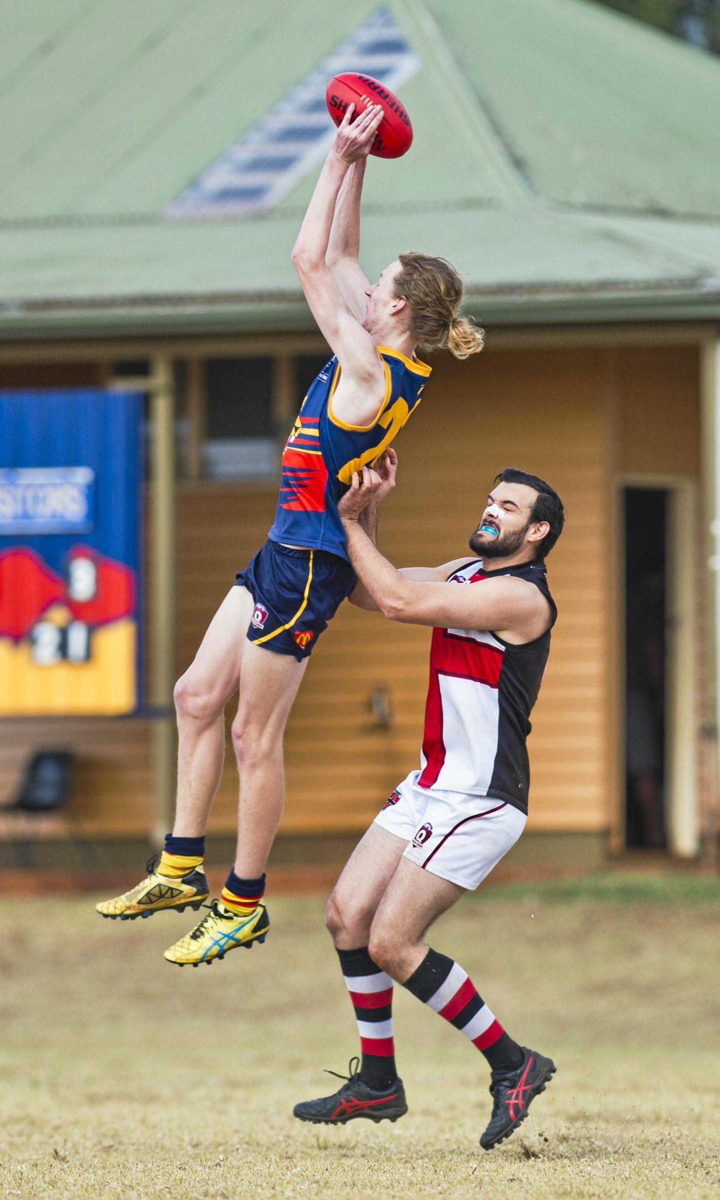 MAGIC MARK: Harry Potter leaps to take a mark in front of South Burnett's Bryce Commerford.