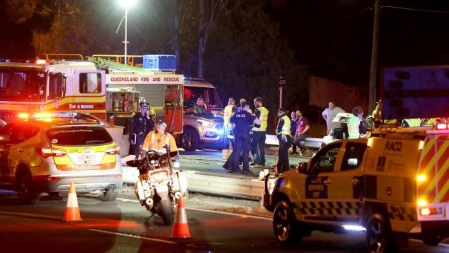 Emergency services attend the scene of the horror Moorooka crash. Picture: AAP/Steve Pohlner