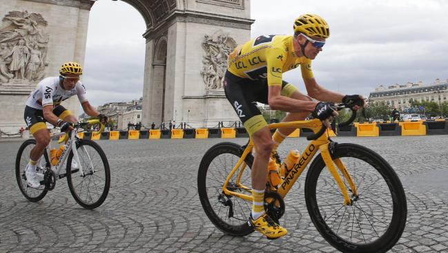 Britain's Chris Froome, wearing the overall leader's yellow jersey, as they pass the Arc de Triomphe on last stage of the 2017 Tour de France.