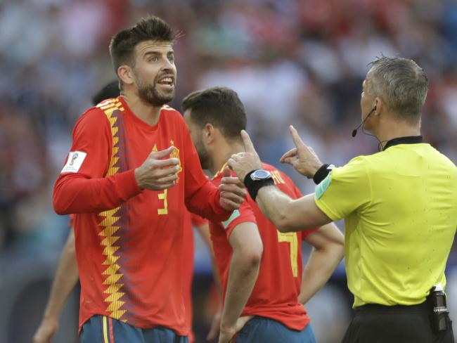 Spain's Gerard Pique argues against the penalty awarded against him. Pic: Getty