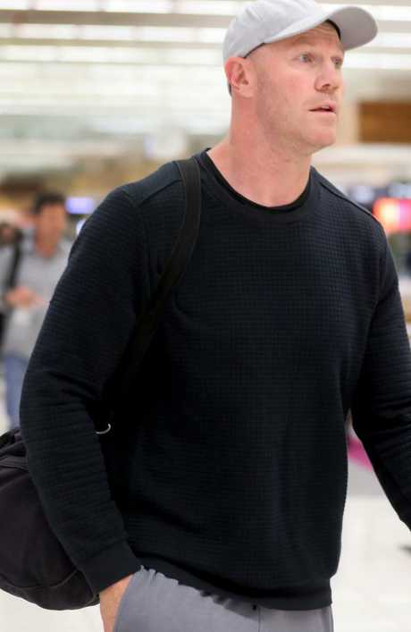Barry Hall at Adelaide Airport on Sunday. Picture: Dean Martin/AAP