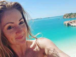Shark drags Aussie woman into water