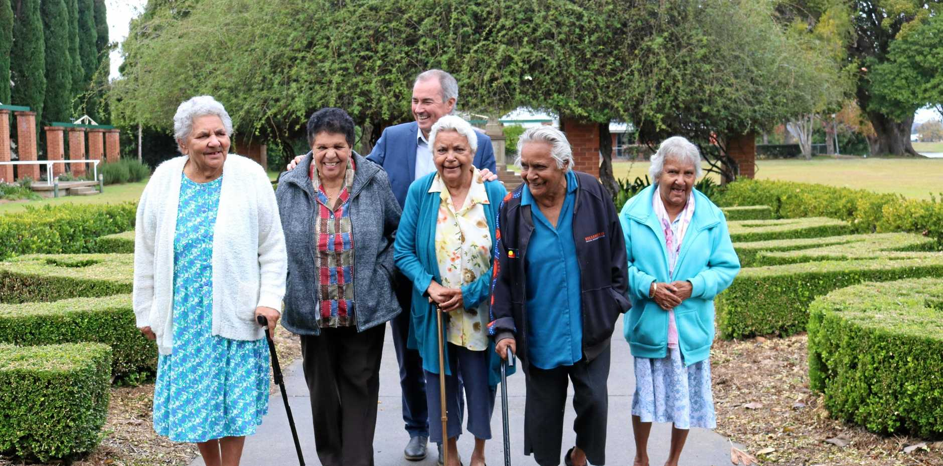 SITE IS SAFE: Aboriginal elders from Baryulgil L-R: Linda Walker, Lana Mundine, Pauline Donnelly, Dorothy Daley & Heather Monaghan are all smiles with Clarence MP, Chris Gulaptis