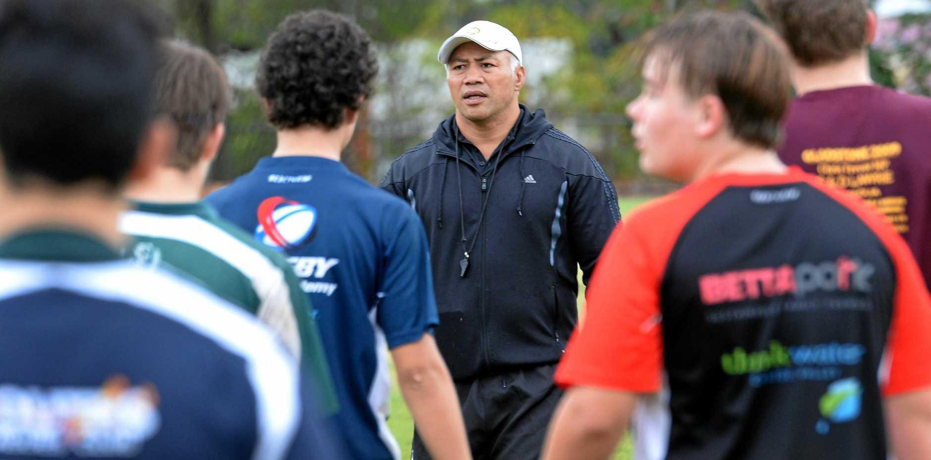 SKILLED UP: Coach Onehunga Mata'uiau puts the CQ Bushrangers under-14 players through their paces at a training camp at Rocky Grammar.