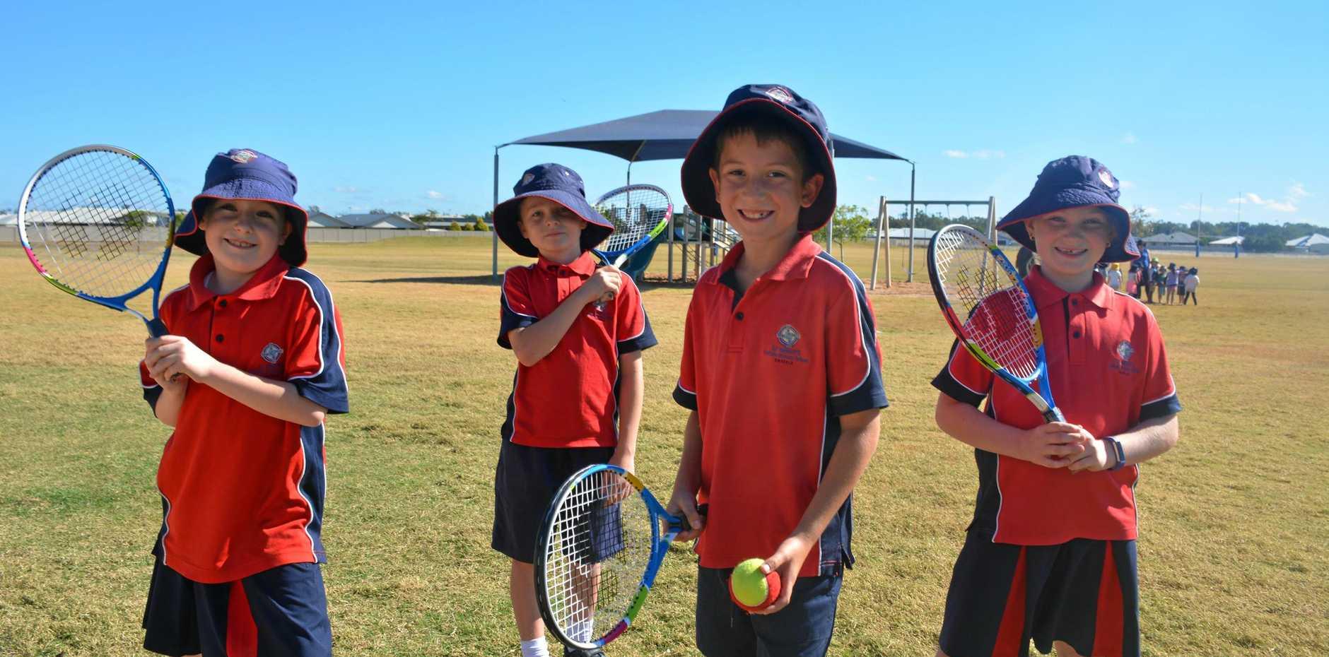 ON FIRE: Safiya Higgins, Aiden Midgely, Flynn Smith and Heidi Edwards trialling their new tennis racquets.