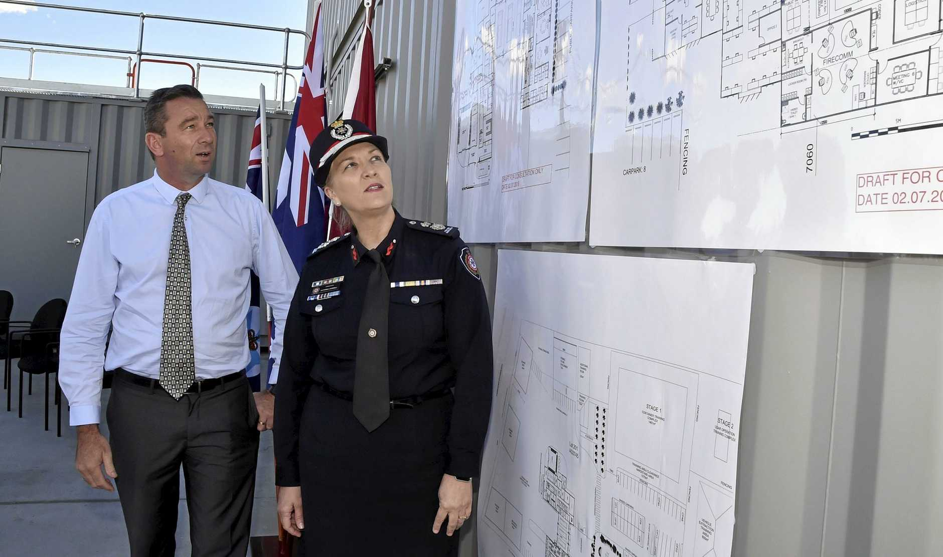 HIGH TECH: Minister Fire and Emergency Services Craig Crawford and QFES Commissioner Katarina Carroll review plans for the new Regional Headquarters and Fire Communications Centre at Charlton.