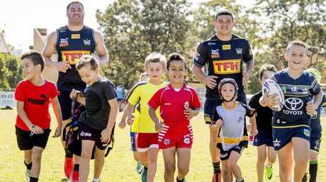 Titans players Brenko Lee and Ash Taylor at the NRL club's school holiday clinic. Picture: Jerad Williams
