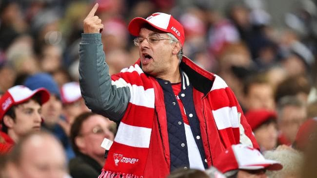 An angry Sydney Swans fan gestures during a match. Picture: Nigel Hallett
