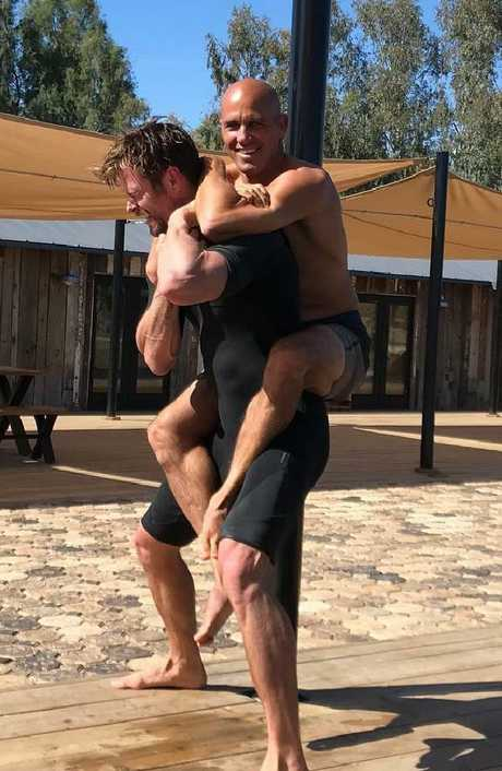 Retirement will give Slater more time to hang with celebrity mates such as Chris Hemsworth. Picture: @chrishemsworth