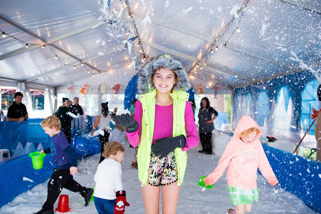 Twelve year old Abbie Dawes enjoys Grand Central's snow pit in Central Square.