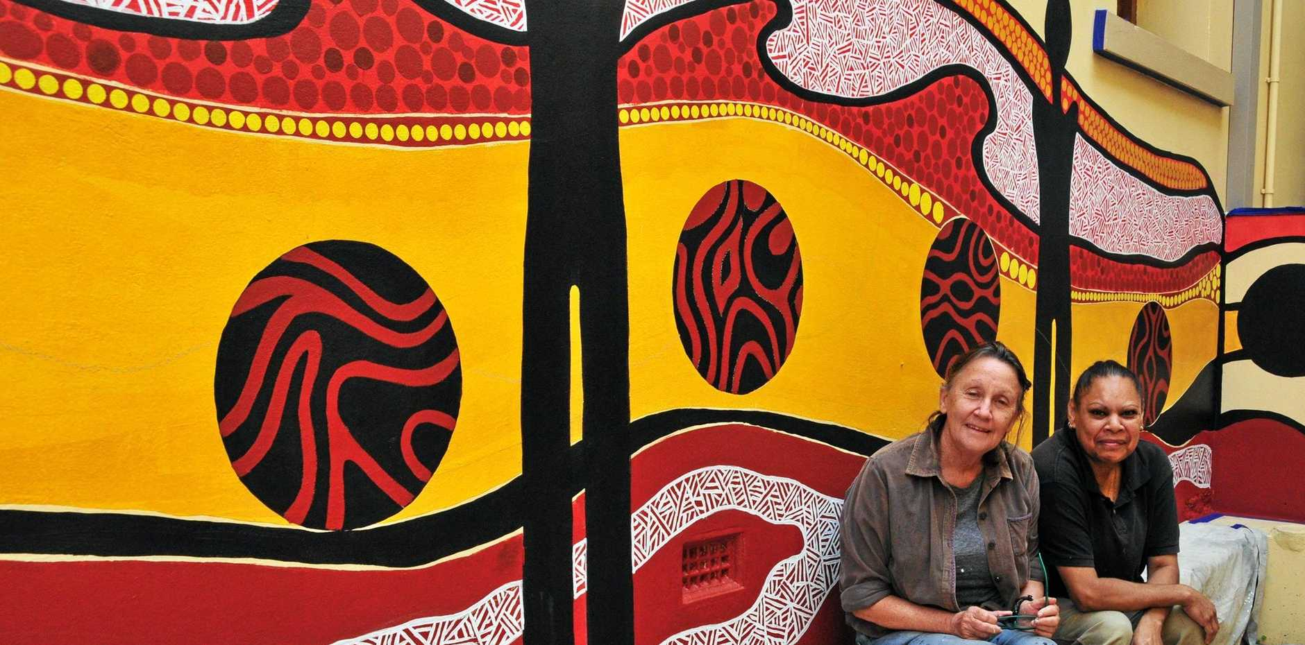 CREATIVITY: Local artists Belynda (Bindi) Waugh (Iman/Bundjalung) and Patricia Coleman (Bailai) work together on a pop-up public art installation at the Gladstone Regional Art Gallery and Museum.
