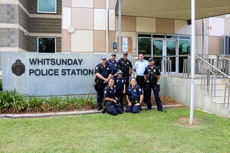 Connor Howse with Whitsunday Police officers outside the station of Tuesday.