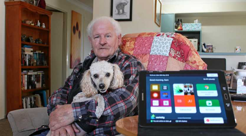 TECH SAVVY: Booval Pensioner Samuel Dalzell is the first Mobi owner in south east Queensland.