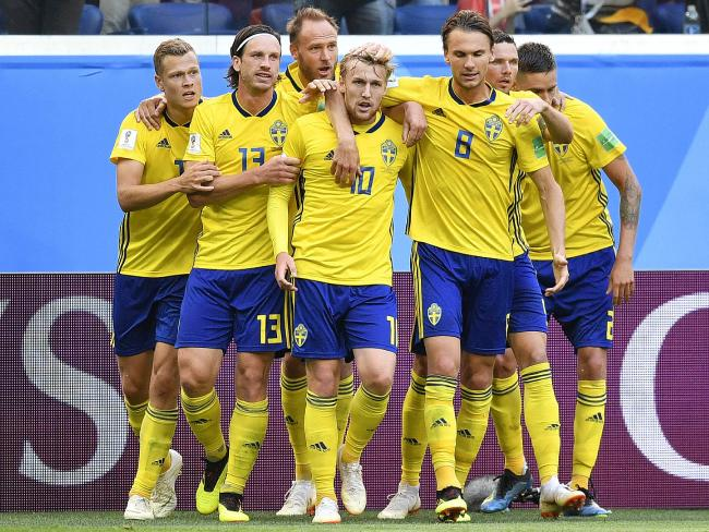 Sweden's Emil Forsberg, center, celebrates with teammates after scoring the game's only goal. Pic: Ap