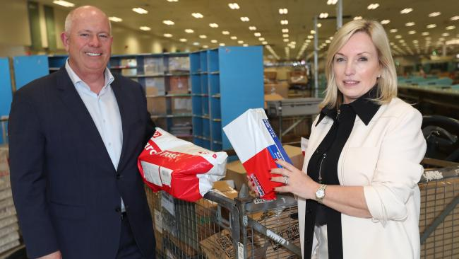 Australia Post chief operating officer Bob Black and managing director Christine Holgate in Brisbane on Wednesday. Picture: Annette Dew
