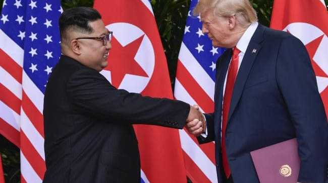 North Korea leader Kim Jong-un and US President Donald Trump shake hands at the conclusion of their meetings in Singapore. Picture: AP
