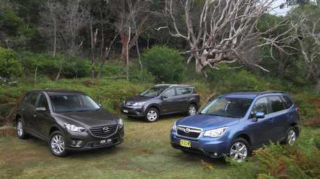 Sales of SUVs such as the Mazda CX-5 (left), Toyota RAV4 (centre) and Subaru Forester (right) continue to outpace small hatches and sedans. Photo: Joshua Dowling.