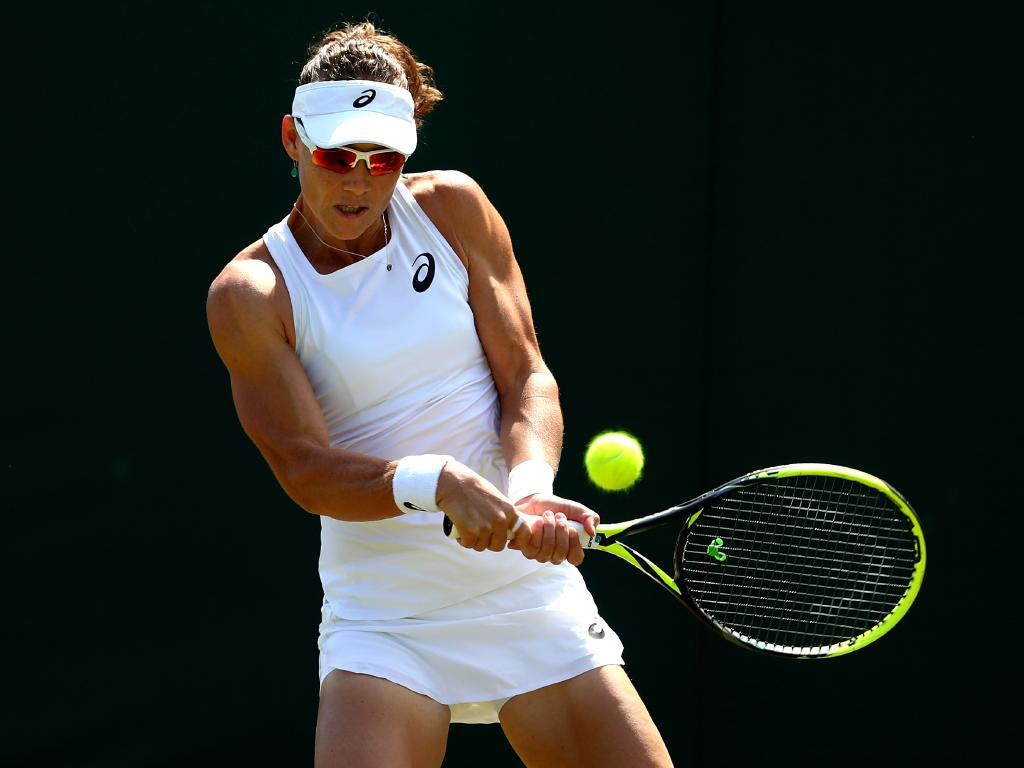 Samantha Stosur of Australia returns against Shuai Peng of China during their Ladies' Singles first round match on day two of the Wimbledon Lawn Tennis Championships. Picture: Getty Images