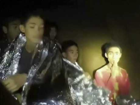 Video footage shows the boys trapped in the cave. The group are being taught how to use diving masks and breathing apparatus.