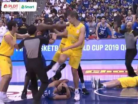 Australia V Philippines brawl blow-by-blow: 4. Blatche shoves Australian Milwaukee Bucks player, Thon Maker, out of the way so he can reach Kickert, who he pushes firmly with both hands in the back.