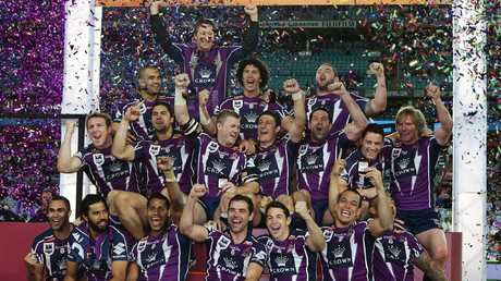 Melbourne Storm celebrate their 2012 NRL grand final win over the Bulldogs.