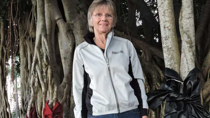 Maryborough's Jo Baker with some of the jackets she has left in Queens Park.