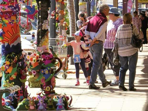 STREET ART: Yarnbombing turns the CBD into a riot of colour.