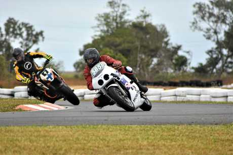 OFF AND RACING: David Carriline (585) shows Peter Meier the art of cornering at the Whitsunday Raceway on Sunday.
