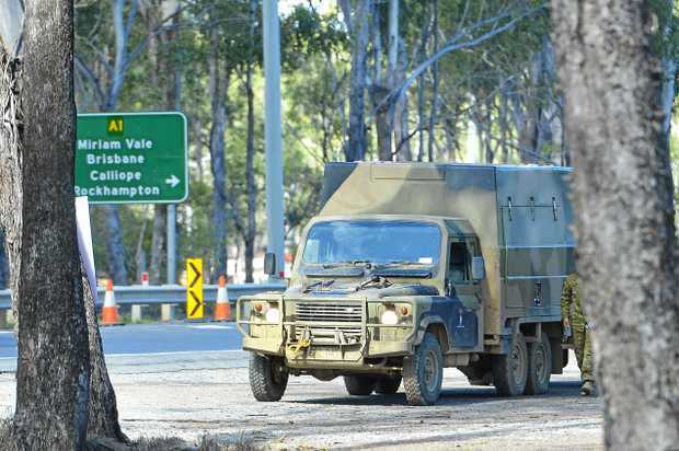 DEFENDER BENDER: An army vehicle sits beside Gladstone Benaraby Rd after one of the vehicles in its convoy was involved in a crash.