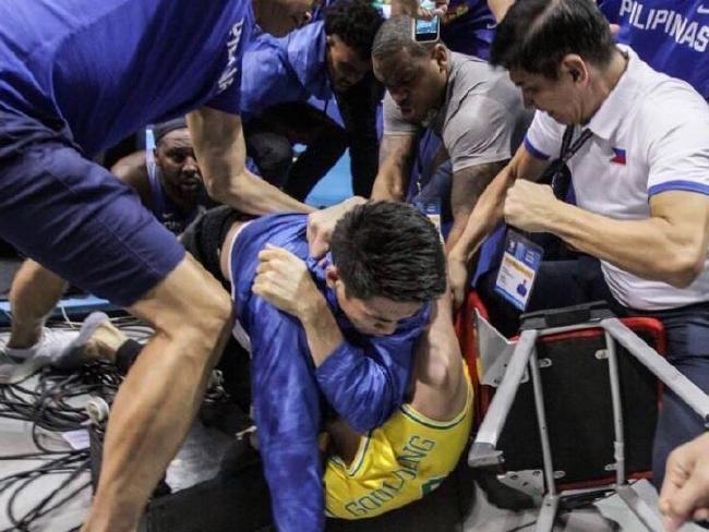 Chris Goulding is set upon by multiple Philippines players and officials. Pic: Getty