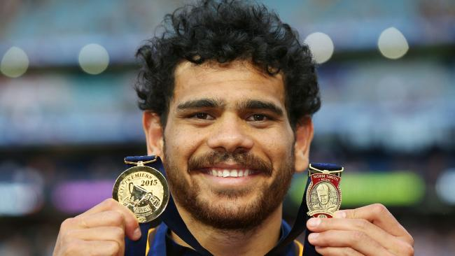 Cyril Rioli poses with his premiership and Norm Smith Medal after the 2015 AFL Grand Final between Hawthorn and West Coast. Picture: MICHAEL DODGE (AFL Media/Getty Images)