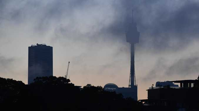Sydney flights have been delayed due to a thick layer of fog blanketing the city.