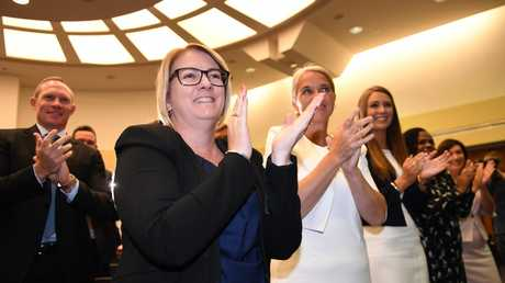 2017: Coralee O'Rourke with fellow members give Premier Annastacia Palaszczuk a standing ovation. (AAP Image/Dan Peled)