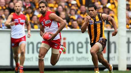 A rare photograph of the only time someone ever outran Cyril Rioli.