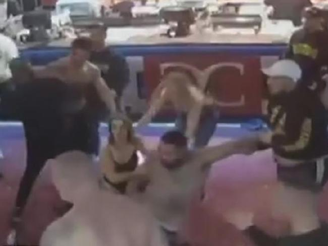 A fight between two men soon turned into a mass brawl.